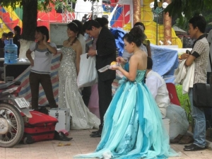 Brides next to Lake Hoan Kiem in Hanoi get ready for their photos